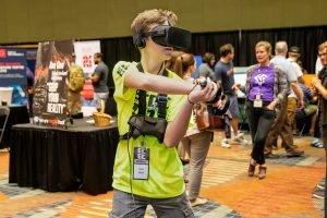 Boy wearing Oculus Rift VR Headset playing a video game at ECGC